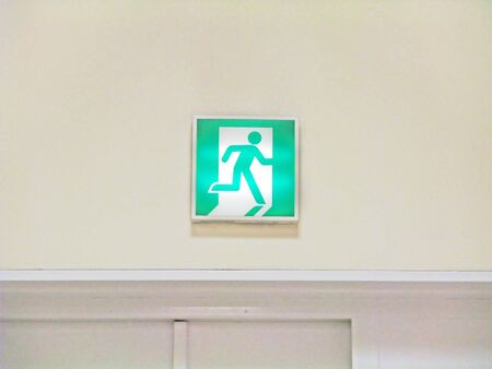 Emergency exit light installed on the wall