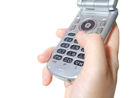 Hand operating a mobile phone