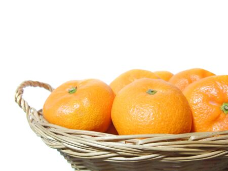 Multiple oranges in a basket Banco de Imagens