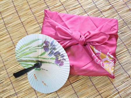 Purple wrapping cloth and floral fan