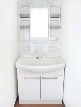 The white toilet is new and clean