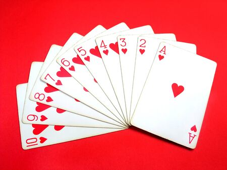 Heart playing cards overlap in a fan shape