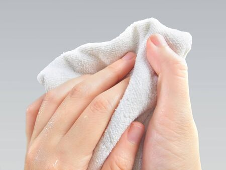 Wiping hands with a towel