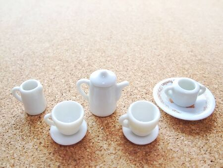 There are toy tea cups and pots