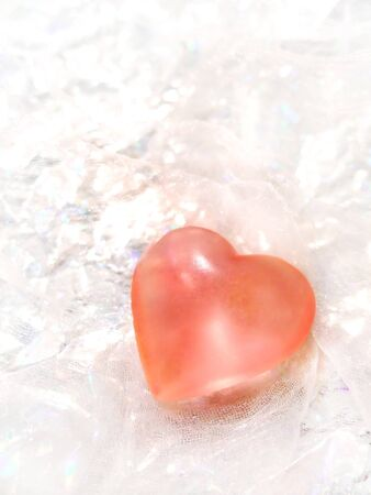 Pink translucent heart made of glass 写真素材