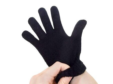 A black glove in one hand