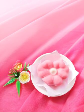 Pink Japanese confectionery in the shape of a plum blossom