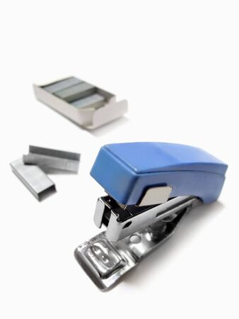 A blue stapler and a dedicated needle Banco de Imagens