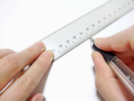 Draw a line using a ruler Фото со стока