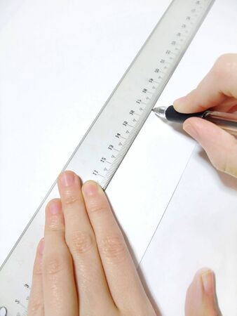 Draw a line using a ruler Banco de Imagens