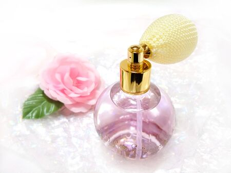 Spray-type perfume bottle and pink rose