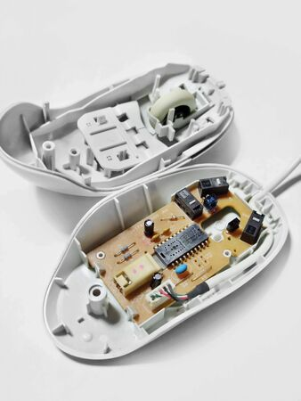 Disassemble the computer mouse into two