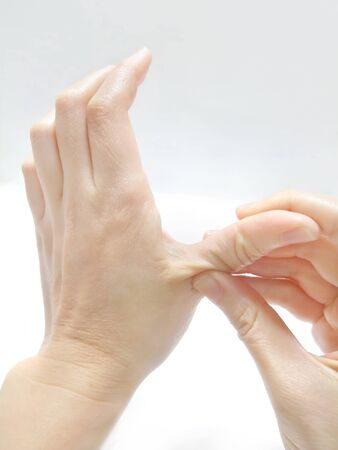 Pressing the palm with finger to massage Фото со стока