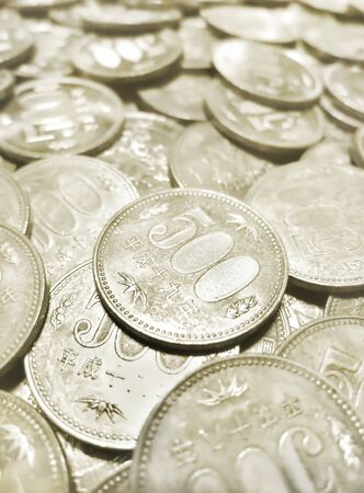 Many 500 yen coins are laid down