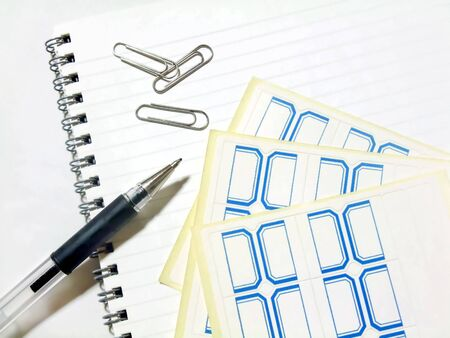 Office supplies such as pens and clips
