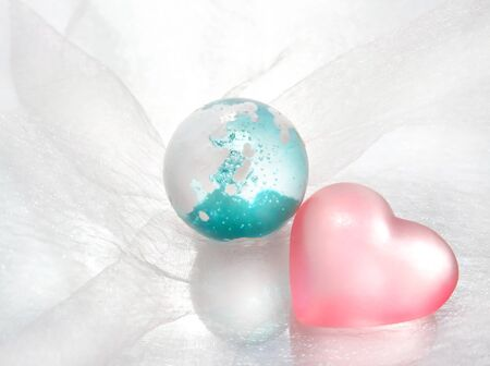 Glass earth and pink heart
