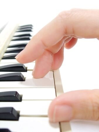 Playing the keyboard by hand Banco de Imagens