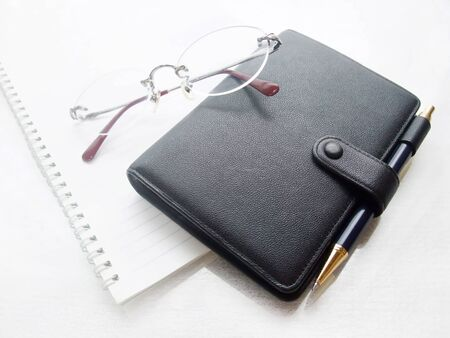 Notebook and glasses and notebook