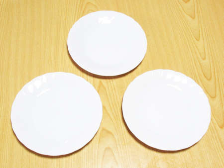 Three white plates