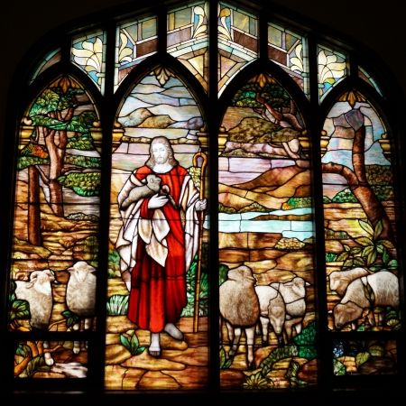 gods: Stained glass windows of Jesus and lambs Editorial