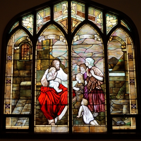 gods: stained glass window of jesus and children