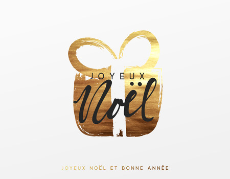 French text Joyeux Noel. Gold Christmas greeting card, Golden Xmas surprise gift box.