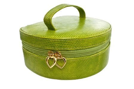Green handbag with gold hearts on a lightning photo