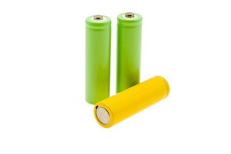 Green and yellow batteries on a white background photo