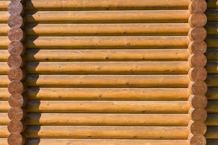 calibrated: The log walls of the house. Wooden wall texture Stock Photo