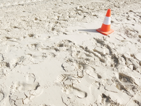 traffic cone: white sand with a traffic cone Stock Photo
