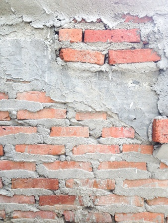 uncompleted: Brick wall with cement concrete texture background Stock Photo