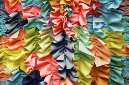ruffle: Bright colorful ruffled fabric background close-up Stock Photo