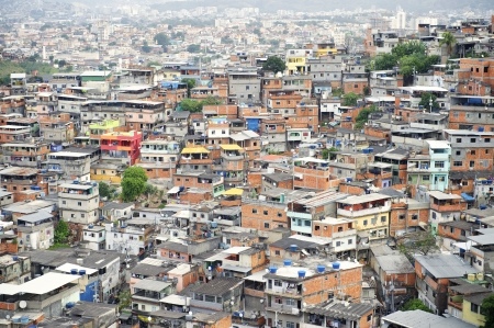 overpopulation: Brazilian favela shantytown covers the hillside in Rio de Janeiro Brazil Complexo Alemao Stock Photo
