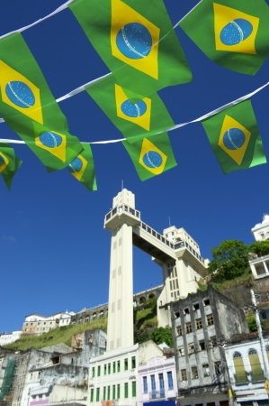 elevador: Brazilian flags fly over sunny view of the elevator in Salvador Brazil Stock Photo