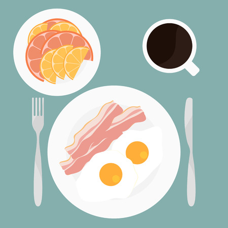 top menu: Breakfast included fried eggs, bacon, slices of orange and grapefruit and cup of coffee top view.