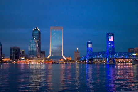 Night scene view of downtown Jacksonville on the water near the blue bridge.