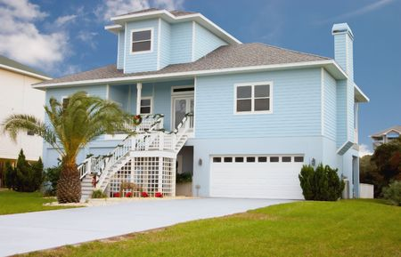 residential homes: bright blue coastal living home in florida Stock Photo