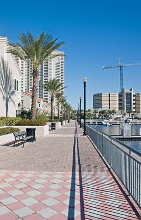 jacksonville: brick paver walkway along the waterfront by luxury condominiums in Jacksonville Stock Photo