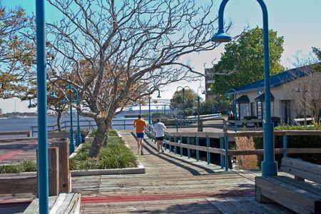 jacksonville: two joggers on Jacksonville riverwalk