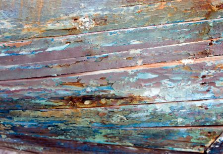 planking: detail of colorful planking on an old fishing boat