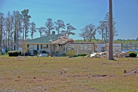 negatively: home negatively impacted by nature, strong winds partially destroyed this wood framed home