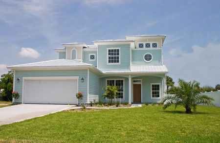 bright pastel blue coastal living home in florida photo