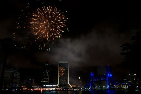night time view of downtown Jacksonville, Florida with reflections of fireworks Stock fotó
