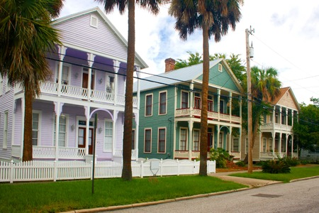colorful, coastal florida victorian style row homes