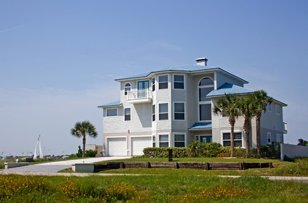 pastel blue coastal living home in Florida on the water Stock fotó