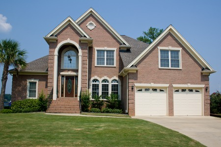 custom, upscale brick home with high arched entry Stock fotó