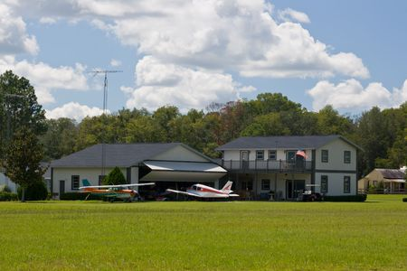 residential airpark community home with hangar and light aircraft Stock Photo