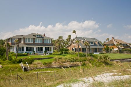 luxury, shake exterior beachfront homes with tropical landscaping photo