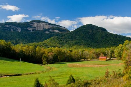 table rock mountain fall scenic with mountain meadow and distant peak