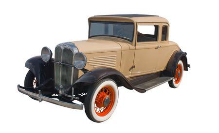 オレンジ色のスポークの車輪を持つ古典的な 1930 年代の日焼けクーペ